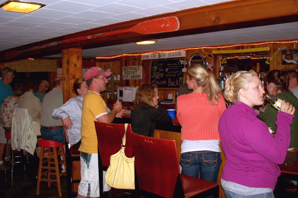 People hanging out at the Peninsula Pines Resort Lodge bar.